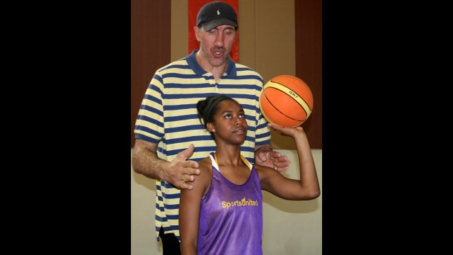 Trained by a pro! Gheorghe Muresan practiced with and gave individual advice to student athletes from the U.S. and Turkey
