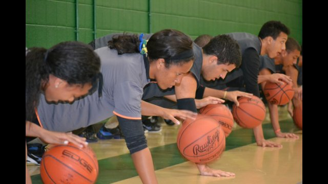 The Brazilian visitors work on dribbling by performing one-handed push-ups.