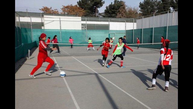 The participants scrimmage with the Afghan Women's National Soccer Team.