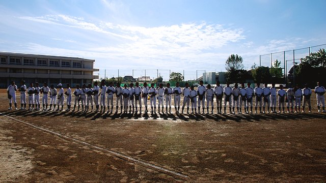 Young athletes line up before Cal Ripken's baseball clinic in Ofunato-Takarazuka City, Japan.