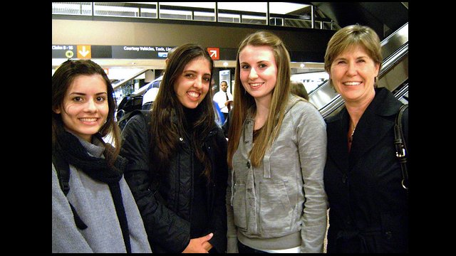 Seattle host families meet Youth Ambassadors at the airport.