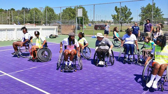 The Colombian visitors learn about disability sports firsthand at Mobility International.