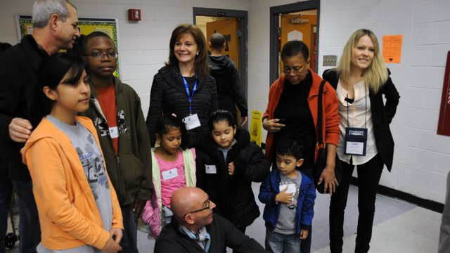 FSB Chairman Tom Healy and FSB Memebr Shelby Lewis interact with children at an Atlanta elementary school as part of a Saturday morning service project.