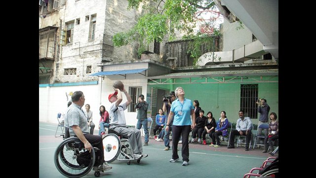 Consul General, Brian L. Goldbeck, participates in a demo at the Guangzhou English Training Center for the Handicapped in China.