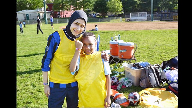 An Egyptian soccer coach poses with another participant at a United for DC volunteer session.