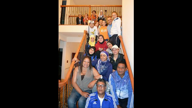 Egyptian soccer coaches were invited to their first dinner in an American household.