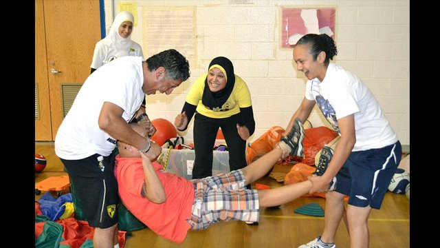 Egyptian soccer coaches engage in sports and disabilities activities.