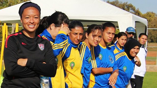 Angie Hucles lines up with program participants during a soccer clinic in Morocco.