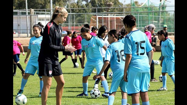 Marian Dalmy shares tips on soccer techniques with young players in Morocco.