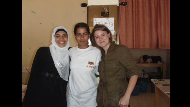 A Camp Counselor with students at the annual American Village English Access Micrsosholarship Summer Program in Aqaba, Jordan.