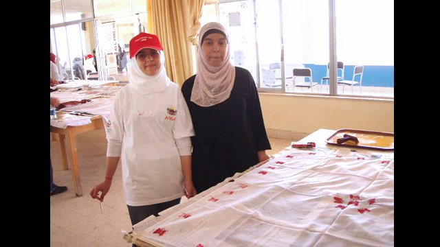 Access students show off their project in Jordan