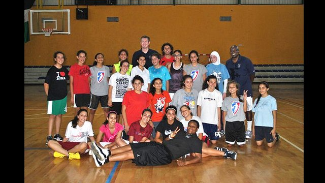 The Envoys pose with a group of young Jordanian female players after a basketball clinic.