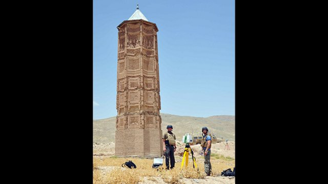 Architects Dana Lockett and Paul Davidson operate the laser scanner in front of the Mas'ud III tower.