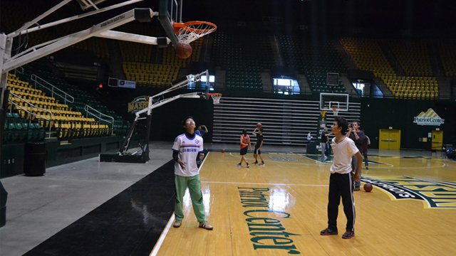The group shoots hoops at George Mason University's Patriot Center.
