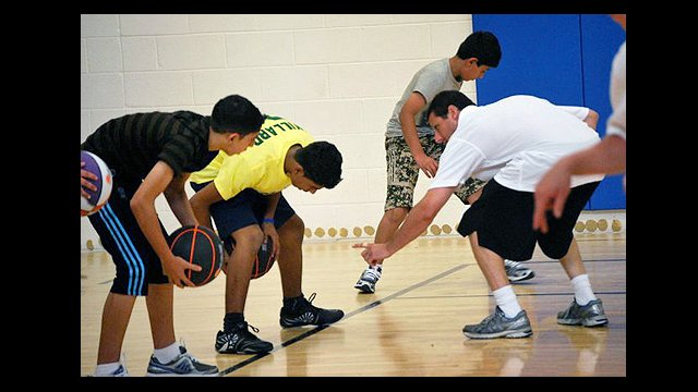Coach Issacson coached the participants through a traditional American basketball practice.