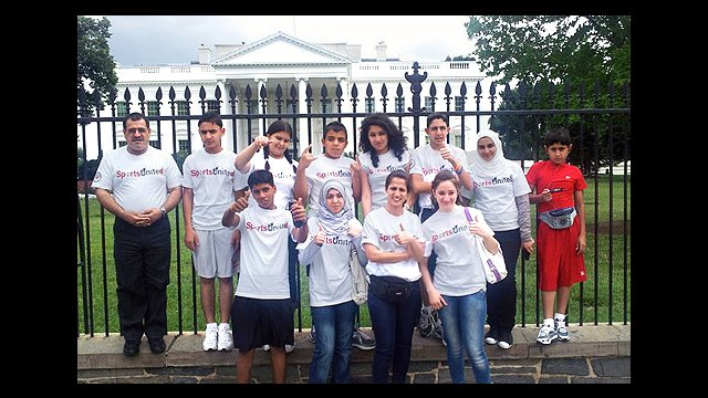 The group enjoys a tour of our nation's capital and poses in front of the White House.