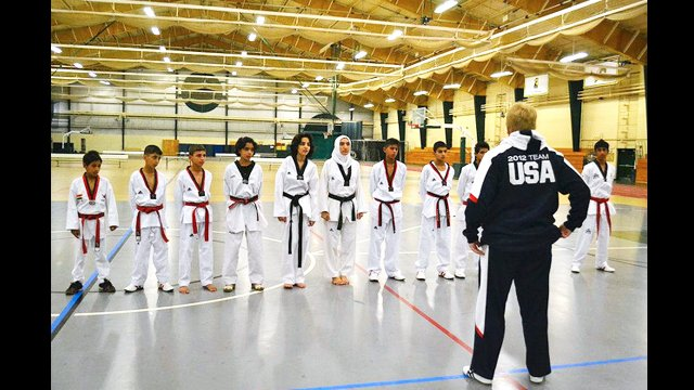 The young Iraqis line up for a clinic with Coach Chuck Thornton at the U.S. Naval Academy.
