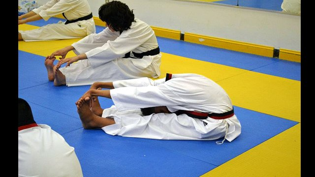 The participants work on their flexibility which gives taekwondo athletes a natural advantage.