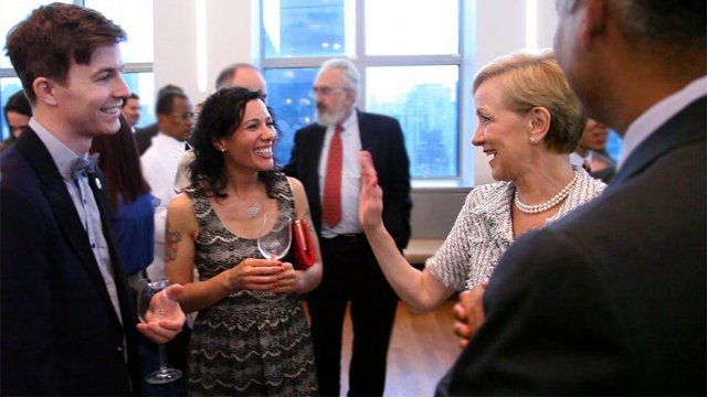 Assistant Secretary Ann Stock (right) chats with 2011-2012 Fulbright-mtvU nominating judges and indie pop band Matt & Kim at a reception celebrating the five-year Fulbright-mtvU relationship. The event was co-hosted by United States Ambassador to the Unit