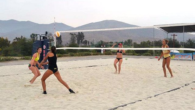 American and Russian girls pair up to play on tournament day at the Olympic Training Center.