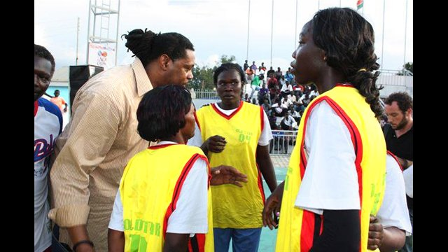 Sports Envoy Sam Perkins coaches the girls basketball team.