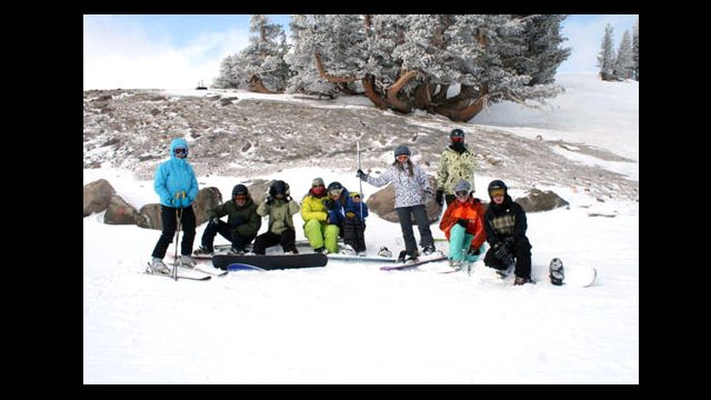 The group of Kyrgyzstani snowboarders get ready to ride.