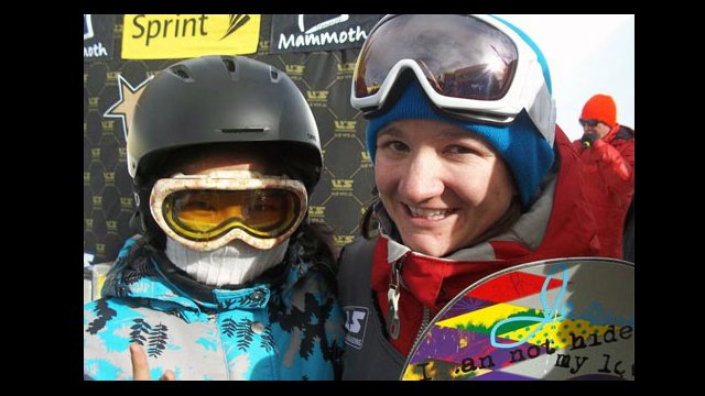 Sports Visitor Nurzat celebrates with the new U.S. Snowboarding Champion, Kelly Clark, after the 2011 Snowboarding Grand Prix.