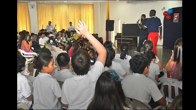 Barry Larkin and Joe Logan interact with girls and boys at Colegio Americano in Ecuador.