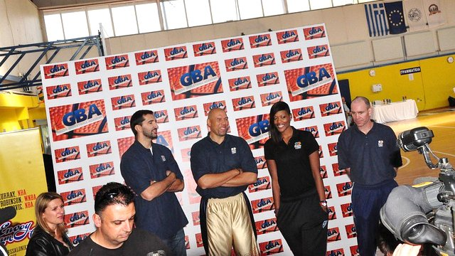 Sports Envoys Tracy Murray, Peja Stojaković, and Ashley Robinson pose at a welcome event by the Greek Basketball Association.