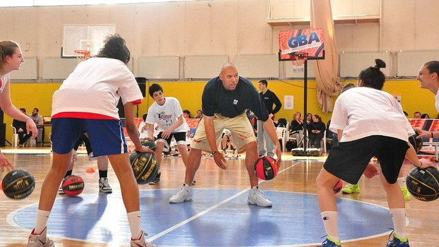 NBA's Tracy Murray leads a ball handling drill with young players during a clinic in Thessaloníki, Greece.