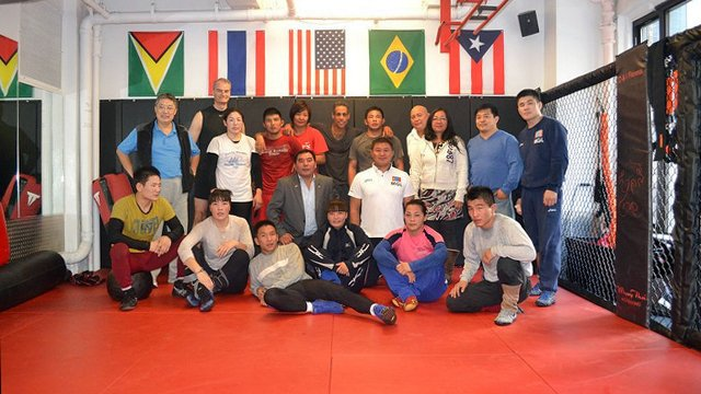 Mongolian Wrestlers pose with Hugh Dugan of the U.S. Mission to the United Nations after training with Jonas Serrano of Phyt Condition in New York City.