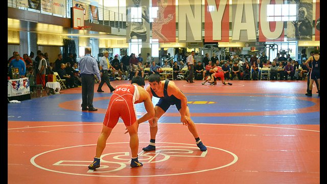 A Mongolian male wrestler competes at the New York Athletic Club (NYAC) Holiday International Event.