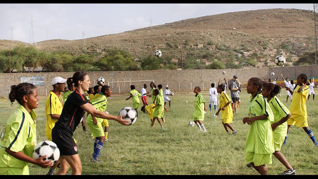 Ethiopian girls enjoy a ball handling drill with Kate Markgraf.