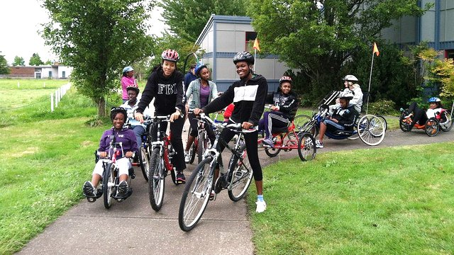 The Caribbean track and field visitors learn about and test out a variety of disability sport bikes at Adaptive Sports in Oregon.