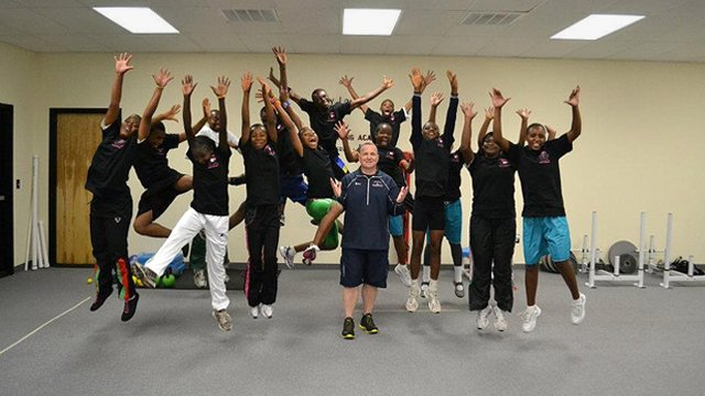 The group celebrates after a special strength and conditioning session with professional trainer Barry Lovelace.