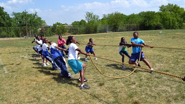 The participants played tug-of-war while working on their teamwork skills.