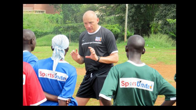 Ian Barker, head men's soccer coach at Macalester College, discusses training with Ugandan coaches.