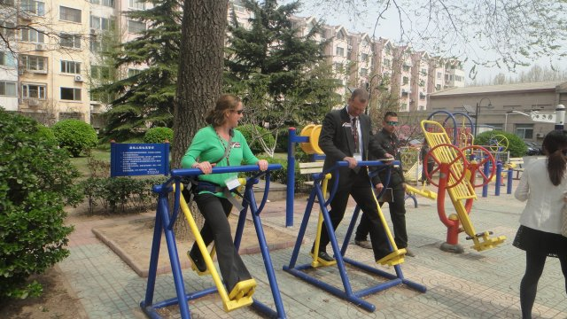 The group enjoys recreational equipment at a local Chinese park.