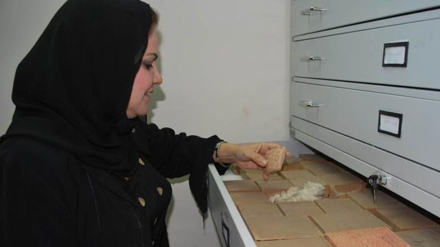 Dr. Amira Edan, director of the Iraq Museum, demonstrates the new storage cabinets for cuneiform tablets and other small objects, July 2010