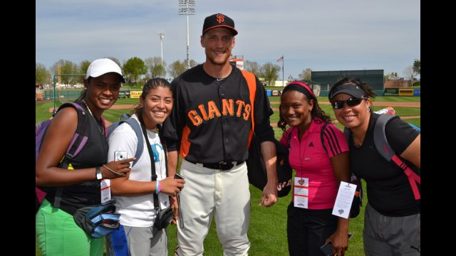 Hunter Pence of the San Francisco Giants and female coaches from the Dominican Republic and Venezuelan.