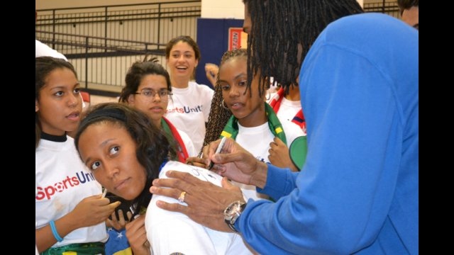 Nene Hilario—an Washington Wizards player from Brazil—signs autographs for the Brazilian youth basketball players.