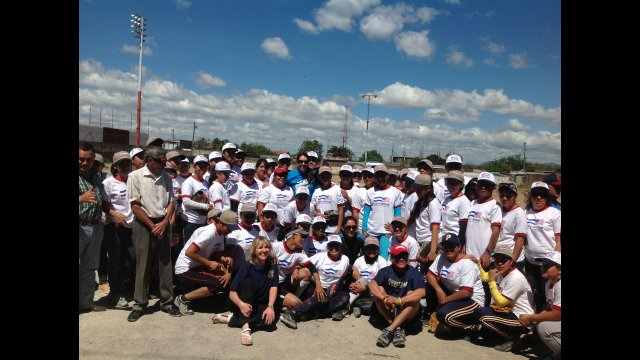 The envoys join in a group photo with Nicaraguan coaches and softball players.