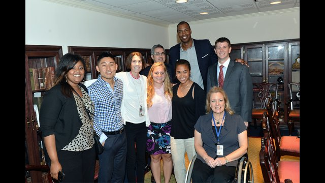 Jason Collins huddles with the State Department's Sports Diplomacy team after the program.