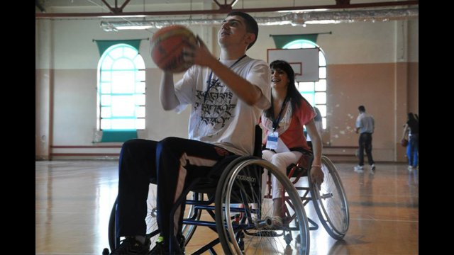 A youth participant goes for the shot during wheelchair basketball.
