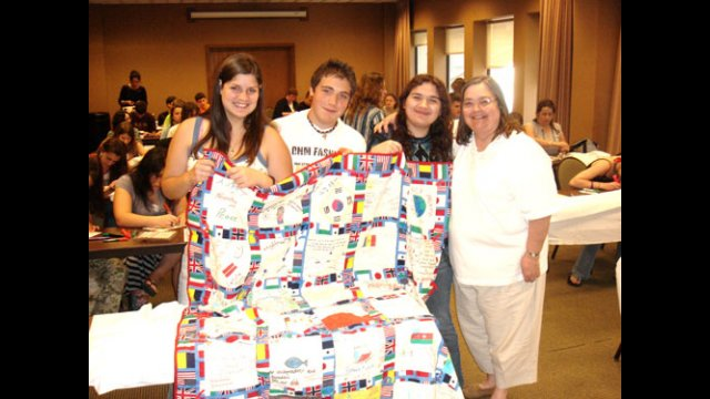 A-SMYLE students make and donate quilts for an orphanage.