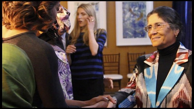 Photo of Oinikhol Bobonazarova greeting first lady Michelle Obama