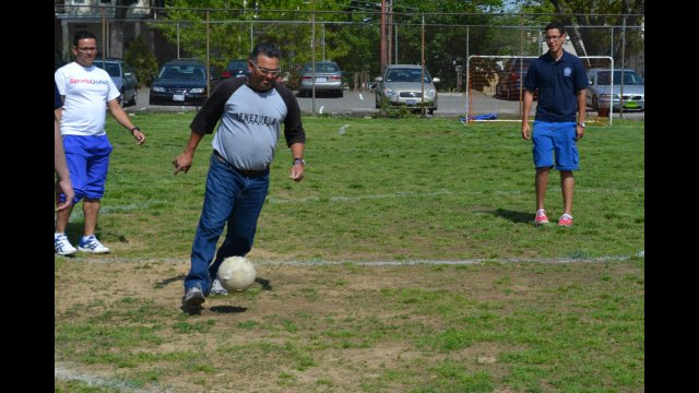 A participant dribbles around during the soccer portion of the exchange
