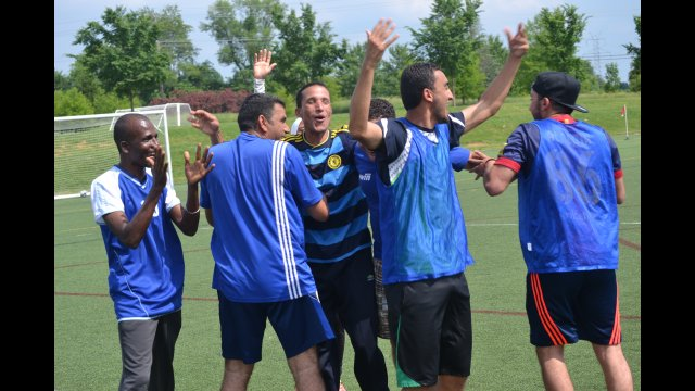 Some of the coaches share their excitement and love of soccer together during a clinic.