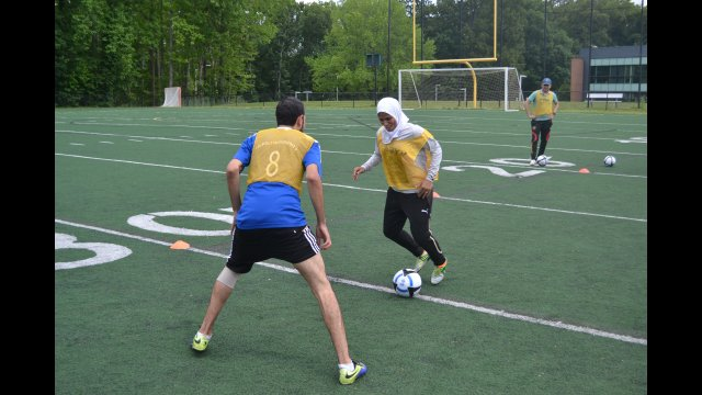 Athletes from Egypt and Libya go one on one during a drill.