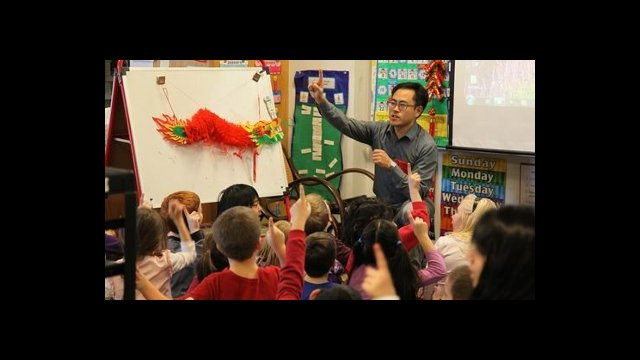 Yu Bo was a Chinese teacher at Arlington High School in Massachusetts during the 2011-2012 school year. He is pictured doing outreach for elementary school children about the Chinese New Year.